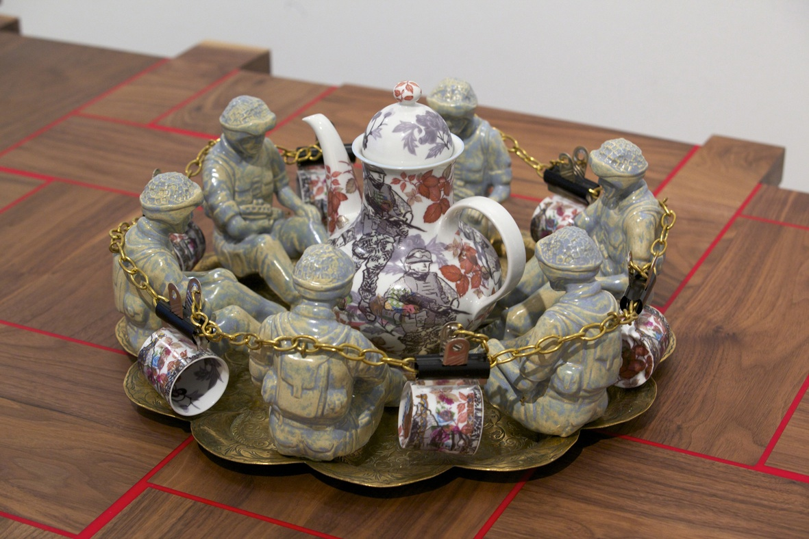 Expeditionary coffee set, 2011,  ceramic figures, found brass tray, chain, found and redecorated coffee pot and cups