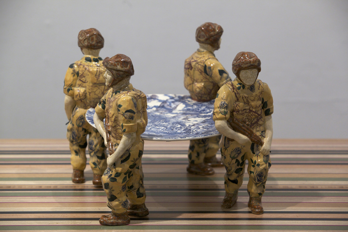 Home Sweet Home, 2011 – Ceramic figures, found plate redecorated owned by the V&A